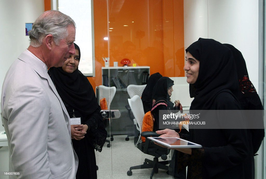Britain's Prince Charles, speaks to women during his visit to the Knowledge Oasis in Muscat, a technology park dedicated to supporting technology-orientated and start-up businesses, on March 19, 2013. The Prince of Wales and his wife Camilla are visiting Oman, the last county on their Middle East tour. AFP PHOTO/MOHAMMED MAHJOUB