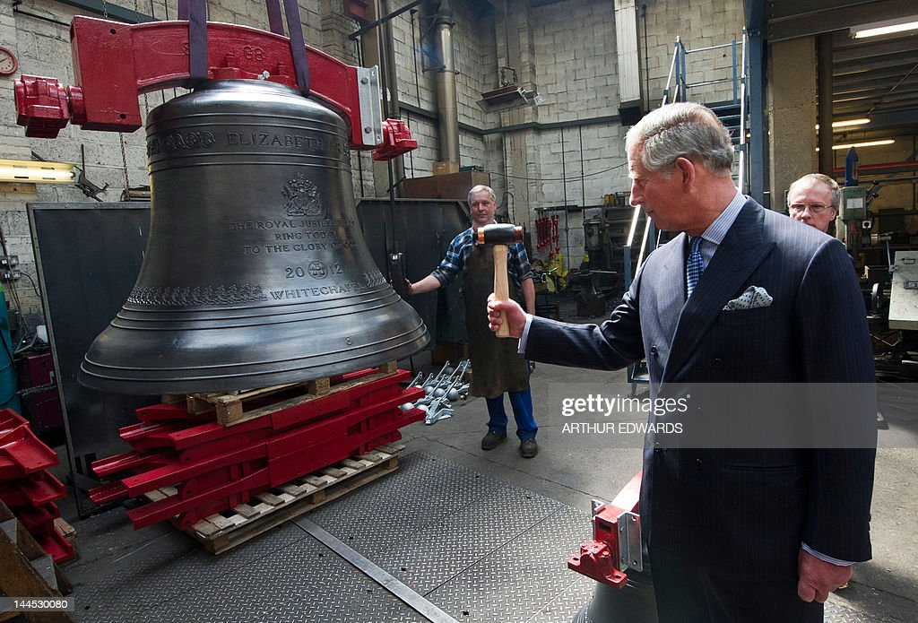 Britain's Prince Charles the Patron of the Thames Diamond Jubilee Pageant strikes a Jubilee Bell named after himself during a visit to the...