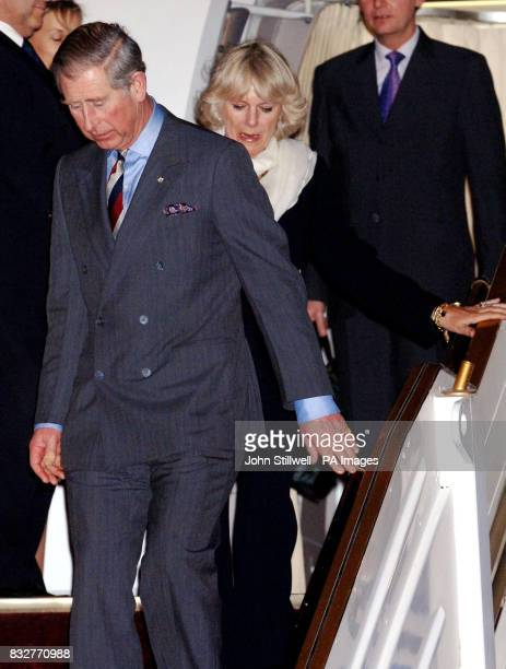Britain's Prince Charles the Prince of Wales and Camilla the Duchess of Cornwall arrive at Kuwait International Airport