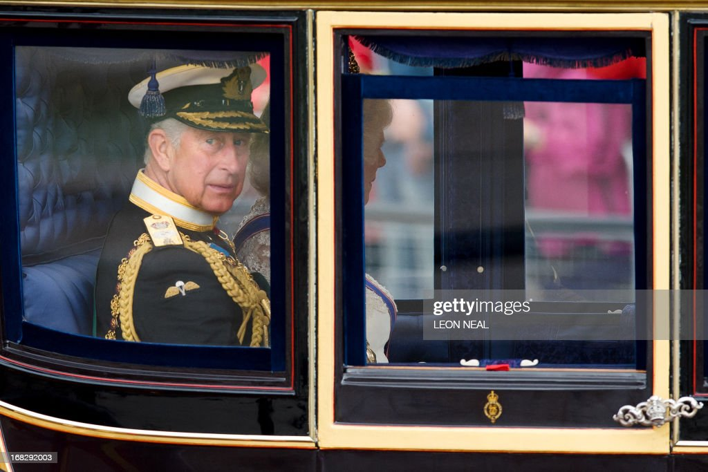 Britain's Prince Charles, The Prince of Wales and His WIfe Camilla, The Duchess of Cornwall leave Buckingham Palace in central London ahead of the State Opening of Parliament on May 8, 2013. Prince Charles was set to attend the state opening of Britain's parliament alongside his mother Queen Elizabeth II, in a sign of his increasing role as his the 87-year-old monarch scales back some duties. The appearance comes a day after Buckingham Palace announced that Charles, the Prince of Wales, will represent his mother at the next Commonwealth heads of government meeting, a gathering she has only missed once in four decades. AFP PHOTO/Leon Neal