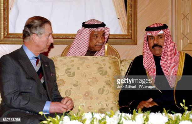 Britain's Prince Charles the Prince of Wales talks to the Crown Prince of Kuwait Sheikh Nawaf Al Ahmed Al Jber Al Sabah with the help of an...