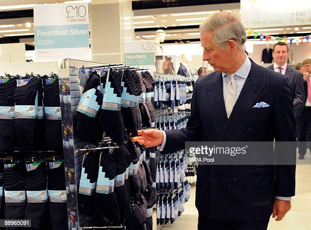 Britain's Prince Charles walks around the Mens Underwear section during a visit to a branch of retail chain Marks and Spencer in the Westfield...