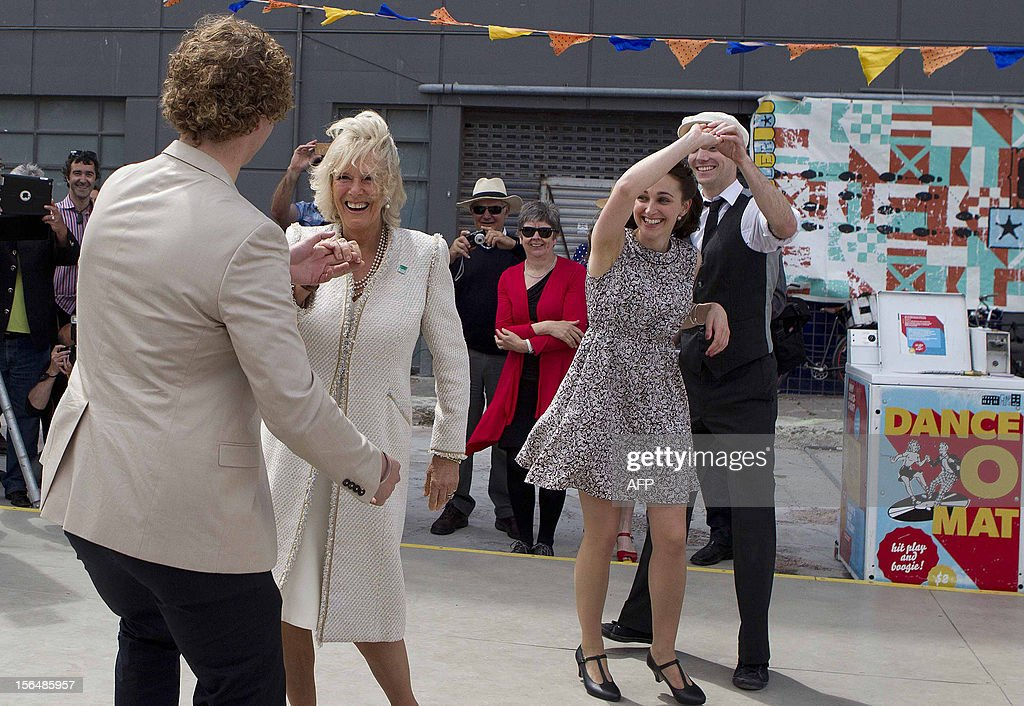 Britain's Prince Charles' wife Camilla (2nd L) dances with local residents during the royal couple's visit to Christchurch on November 16, 2012. Britain's Prince Charles and his wife Camilla are on the last leg of a tour to mark Queen Elizabeth II's diamond jubilee which has also included Papua New Guinea and Australia and ends on November 16. AFP PHOTO / POOL / Kirk Hargreaves