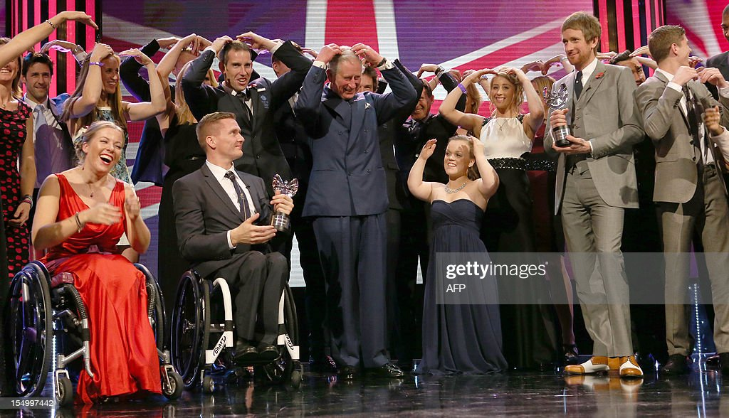 Britain's Prince Charles (C) with British Olympic and Paralympic athletes David Weir (2L), Eleanor Simmonds (2R) and cyclist Bradley Wiggins (R) pose for a picture, some doing the 'Mo-Bot' celebration of distance runner Mo Farah at the Pride of Britain Awards in London on October 29, 2012.