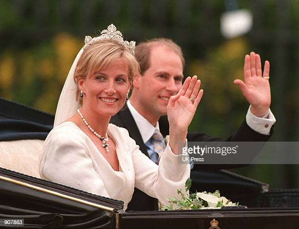 Britain's Prince Edward and Sophie RhysJones wave to the crowd from an open carriage after being married in St George's Chapel within the grounds of...