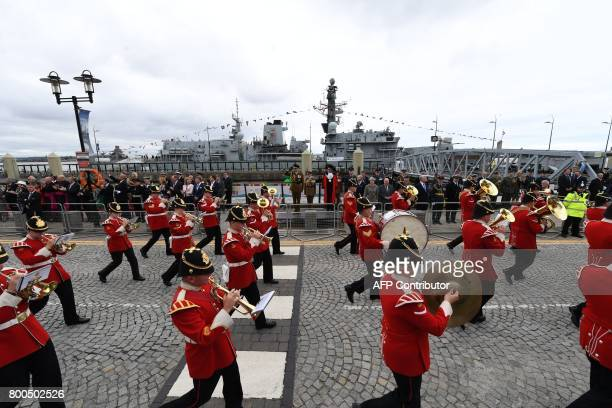 Britain's Prince Edward Earl of Wessex and Britain's Prime Minister Theresa May watch a parade of military personnel in front of the Royal Navys...