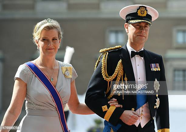 Britain's Prince Edward Earl of Wessex and his wife Britain's Sophie Countess of Wessex arrive for the wedding of Sweden's Crown Prince Carl Philip...