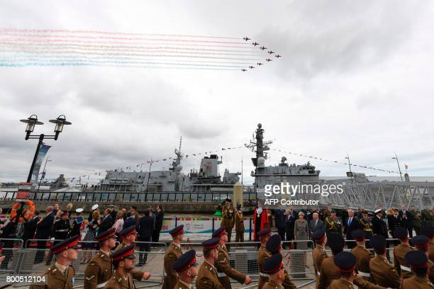 Britain's Prince Edward Earl of Wessex Britain's Prime Minister Theresa May and spectators watch a flypast by the Red Arrows in front of the Royal...