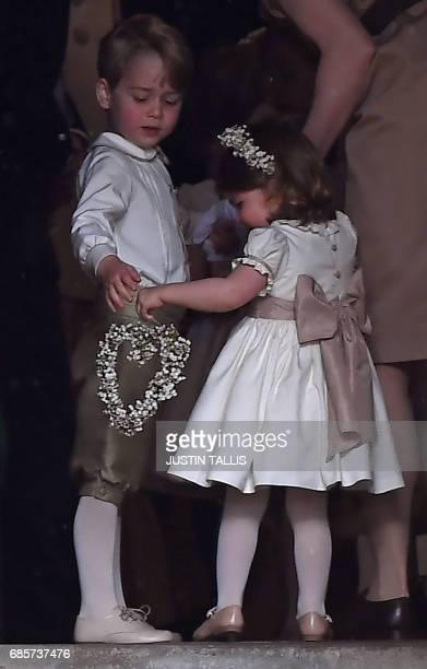 Britain's prince George a pageboy attends the wedding of his aunt Pippa Middleton to James Matthews at St Mark's Church in Englefield west of London...