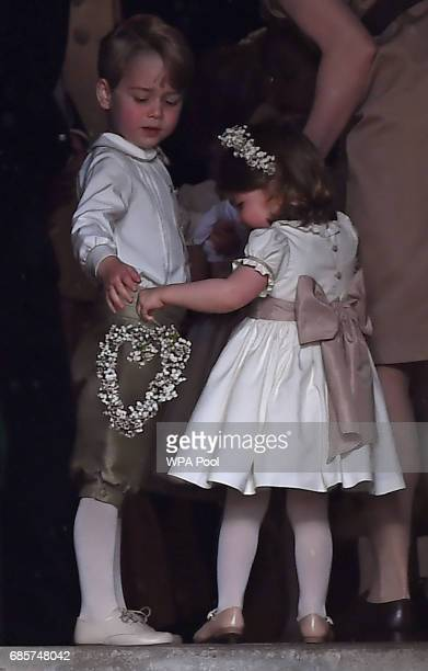 Britain's prince George a pageboy attends the wedding of his aunt Pippa Middleton to James Matthews at St Mark's Church on May 20 2017 in Englefield...
