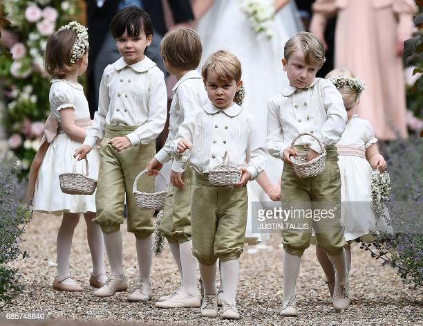 TOPSHOT Britain's prince George a pageboy reacts following the wedding of his aunt Pippa Middleton to her new husband James Matthews at St Mark's...