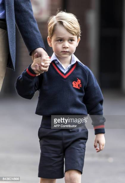 Britain's Prince George accompanied by Britain's Prince William Duke of Cambridge arrives for his first day of school at Thomas's school in Battersea...