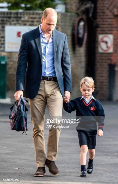 TOPSHOT Britain's Prince George accompanied by Britain's Prince William Duke of Cambridge arrives for his first day of school at Thomas's school in...
