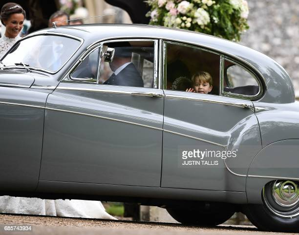 Britain's Prince George waves as he leaves in a car after attending the wedding of his aunt Pippa Middleton to James Matthews at St Mark's Church in...