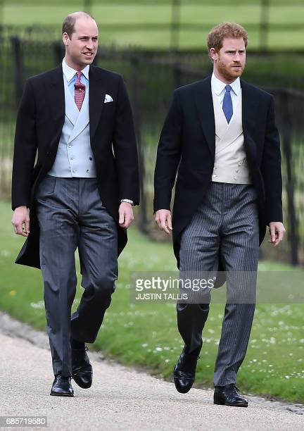 Britain's Prince Harry and Britain's Prince William Duke of Cambridge walk to the church for the wedding of Pippa Middleton and James Matthews at St...