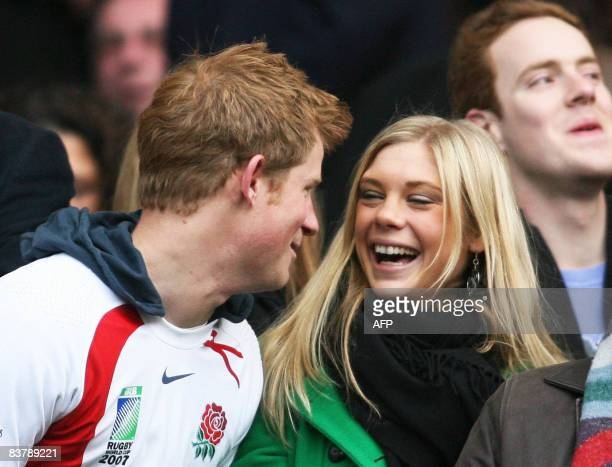 Britain's Prince Harry and Chelsy Davy laugh before the game between South Africa and England at the Investec Challenge international rugby match at...