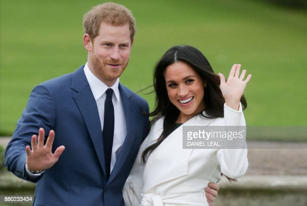 Britain's Prince Harry and his fiancée US actress Meghan Markle pose for a photograph in the Sunken Garden at Kensington Palace in west London on...