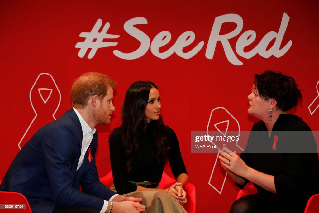Britain's Prince Harry (L) and his fiancee US actress Meghan Markle (C) take part in a discussion with HIV consultant doctor Laura Waters (R) during their visit to the Terrence Higgins Trust World AIDS Day charity fair at Nottingham Contemporary, as part of their first set of official public engagements together, on December 1, 2017 in Nottingham, England. Prince Harry and Meghan Markle announced their engagement on Monday 27th November 2017 and will marry at St George's Chapel, Windsor in May 2018.