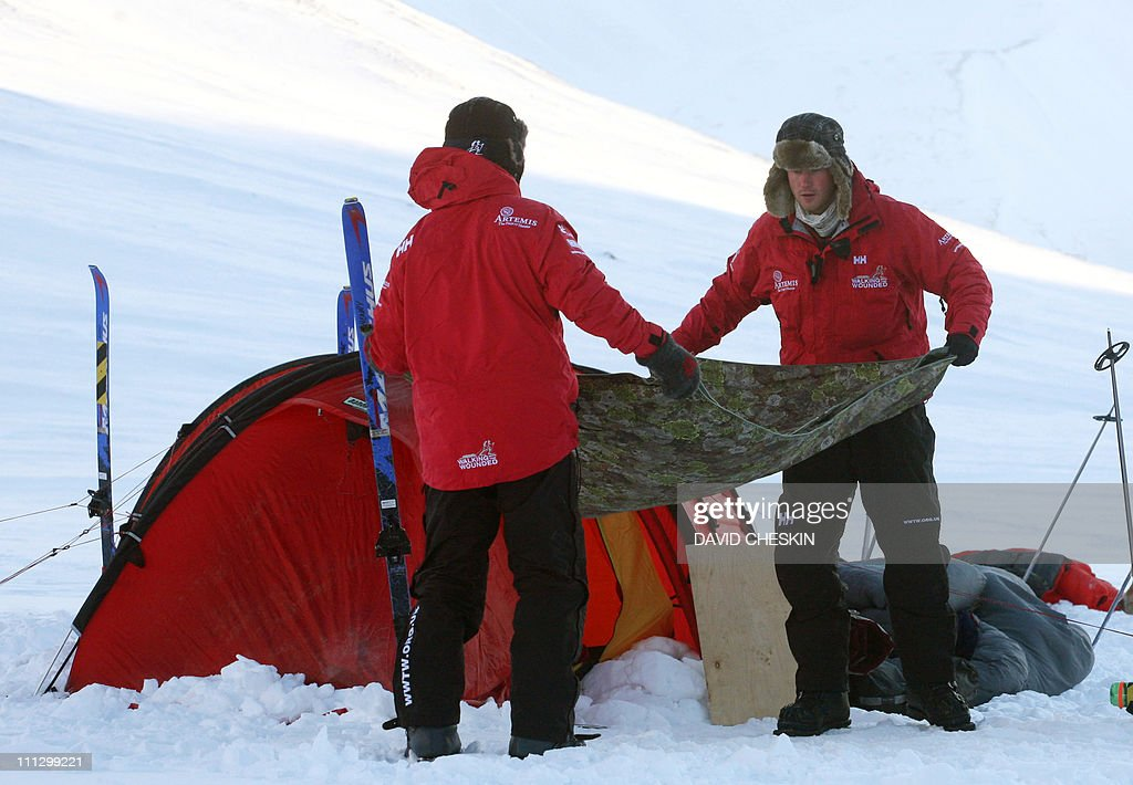 Britain's Prince Harry (R) and Inge Solheim take down his tent during training with the Walking with the Wounded team as they prepare to set off to walk to the North Pole, on the island of Spitsbergen, situated between the Norwegian mainland and the North Pole, on March 31, 2011. Britain's Prince Harry will join the team for the first five days of the trek to the North Pole. The team's expedition will last four weeks and see them cover up to 200 miles (320 kilometres) of the frozen Arctic Ocean on foot, pulling their own equipment in temperatures as low as minus 60 degrees Centigrade. AFP PHOTO/David Cheskin/WPA