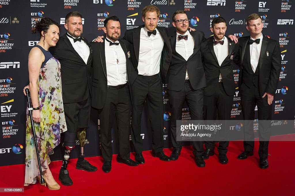 Britain's Prince Harry (C) and members of the British Invictus Games Team attend the BT Sport Industry Awards 2016 in London, United Kingdom on April 28, 2016.