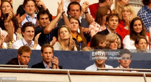 Britain's Prince Harry and Prince William and Prince William's exgirlfriend Kate Middleton in the crowd during the charity concert in memory of Diana...