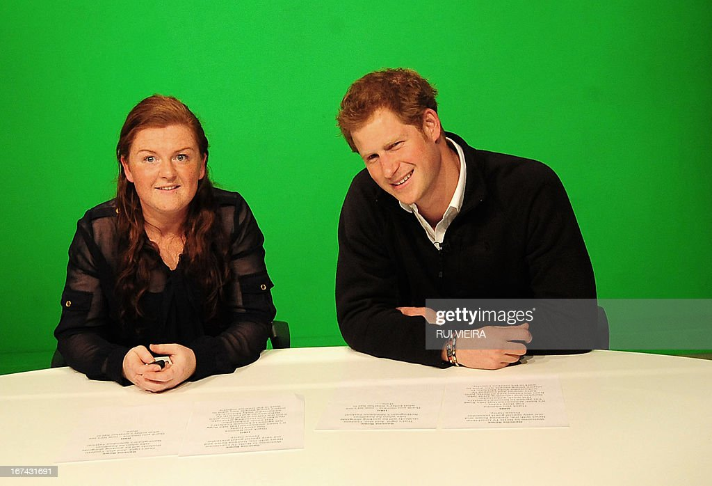 Britain's Prince Harry (R) and student Gemma Rowe prepare to present an in house TV show during a visit to the Confetti Institute of Creative Technologies in Nottingham on April 25, 2013. AFP PHOTO/POOL/ Rui Vieira