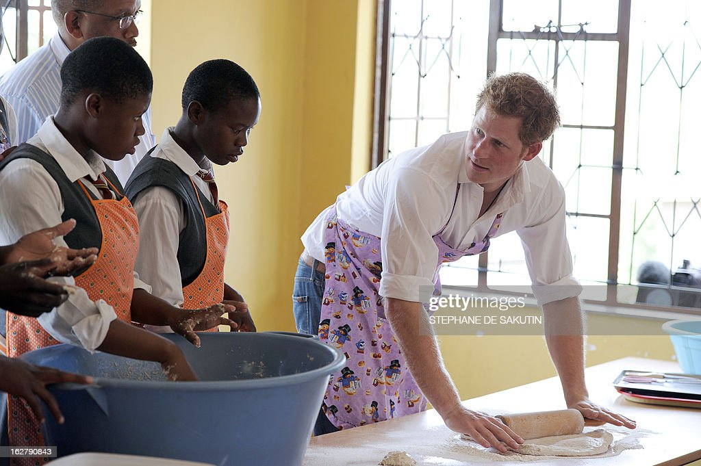 Britain's Prince Harry bakes at the Kananelo Centre for the Deaf on February 27, 2013 in Maseru. Prince Harry visited his charity projects in Lesotho today during his return visit to the southern African kingdom. The projects work with Sentebale, an organisation which Harry set up with Prince Seeiso of Lesotho. The third-in-line to the British throne will travel to Johannesburg in neighbouring South Africa in the afternoon for a fund-raising gala dinner.