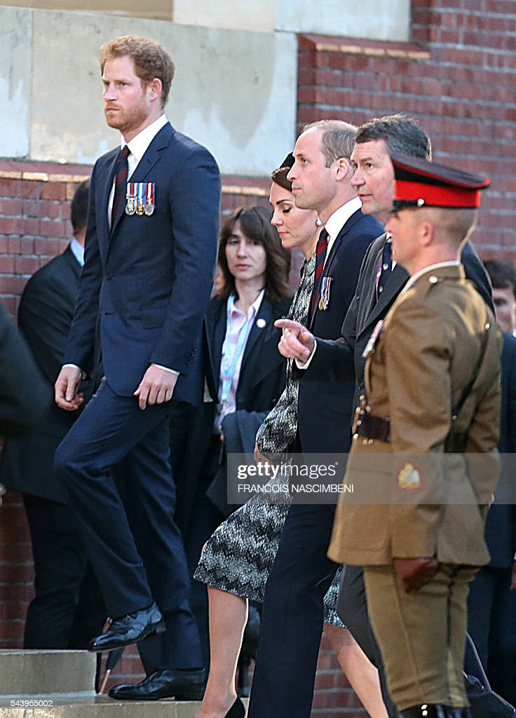 Britain's Prince Harry (L), Britain's Prince William (C) and his wife Catherine (Rear) attend the commemoration of the 100th anniversary of the Battle of the Somme, the deadliest battle in British history in which 20,000 men died on the first day of combat alone, on June 30, 2016 at the Thiepval Memorial, northern France. / AFP / FRANCOIS