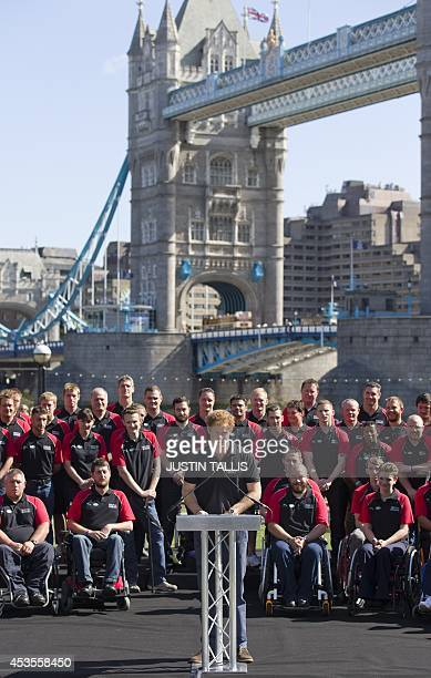 Britain's Prince Harry delivers his speech at the announcement of the British armed forces team for the Invictus Games in London on August 13 2014...