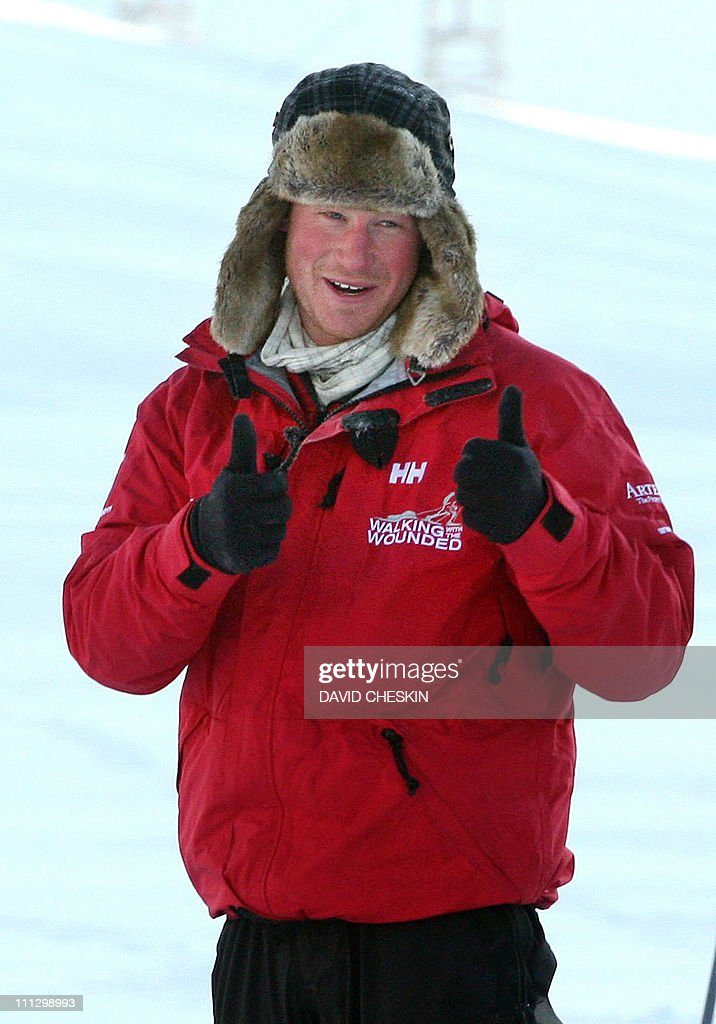 Britain's Prince Harry gestures during training with the Walking with the Wounded team as they prepare to set off to walk to the North Pole, on the island of Spitsbergen, situated between the Norwegian mainland and the North Pole, on March 31, 2011. Britain's Prince Harry will join the team for the first five days of the trek to the North Pole. The team's expedition will last four weeks and see them cover up to 200 miles (320 kilometres) of the frozen Arctic Ocean on foot, pulling their own equipment in temperatures as low as minus 60 degrees Centigrade. AFP PHOTO/David Cheskin/WPA POOL