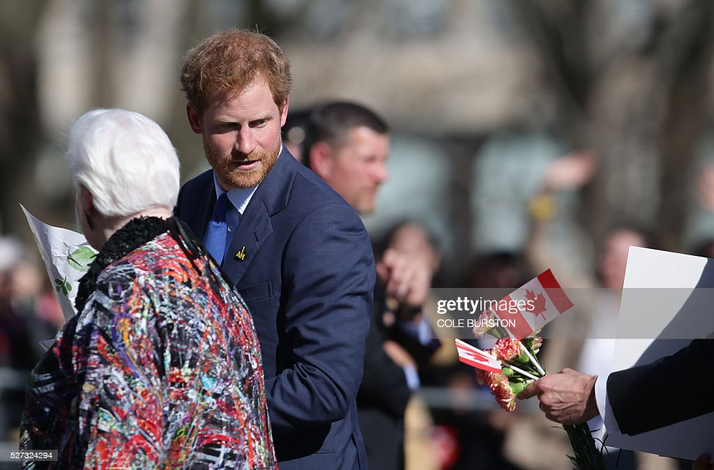Britain's Prince Harry greets admirers outside of Queens Park in Toronto, Canada on May 2, 2016 after spending the day in the city promoting the 2017 Invictus Games, which will be held in Toronto. / AFP / Cole Burston