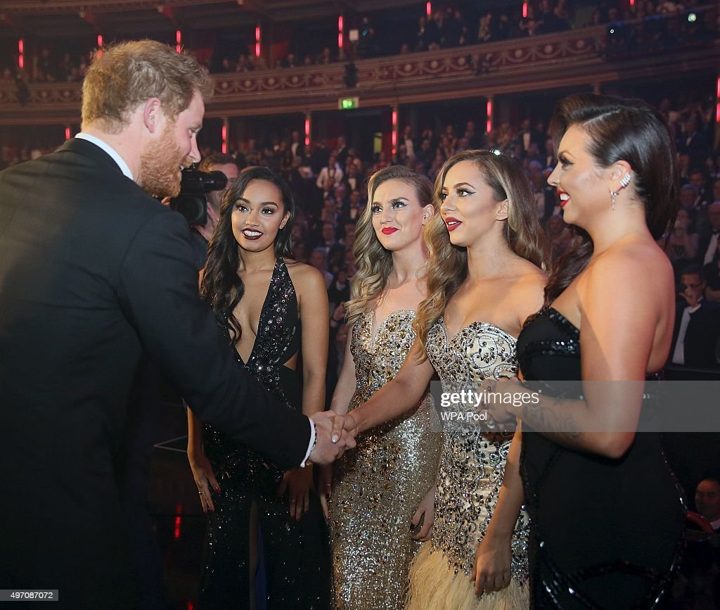 Britain's Prince Harry greets members of Little Mix after the Royal Variety Performance at the Albert Hall on November 13, 2015 in London, England.