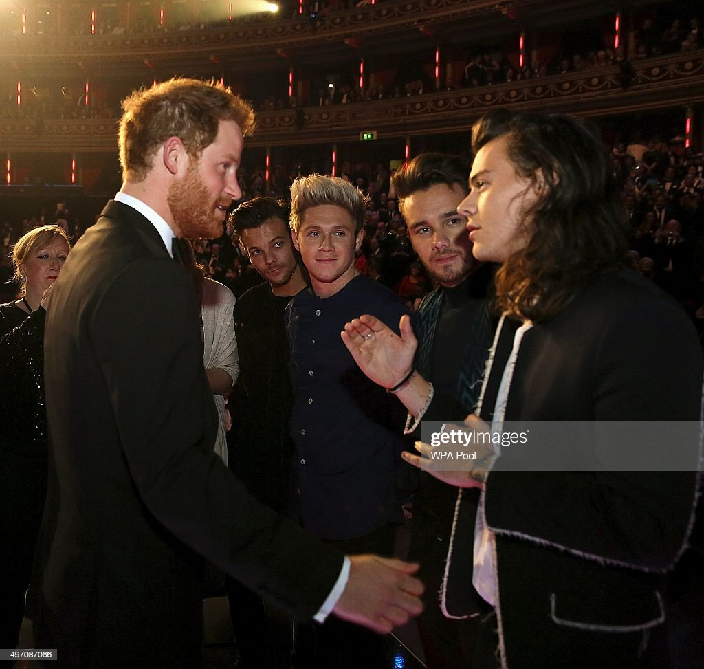 Britain's Prince Harry greets members of One Direction after the Royal Variety Performance at the Albert Hall on November 13, 2015 in London, England.