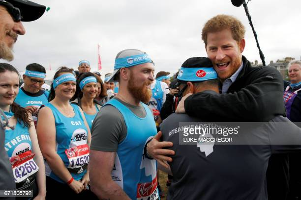 Britain's Prince Harry greets runners representing the charity 'Heads Together' before officially starting 2017 London Marathon in London on April 23...