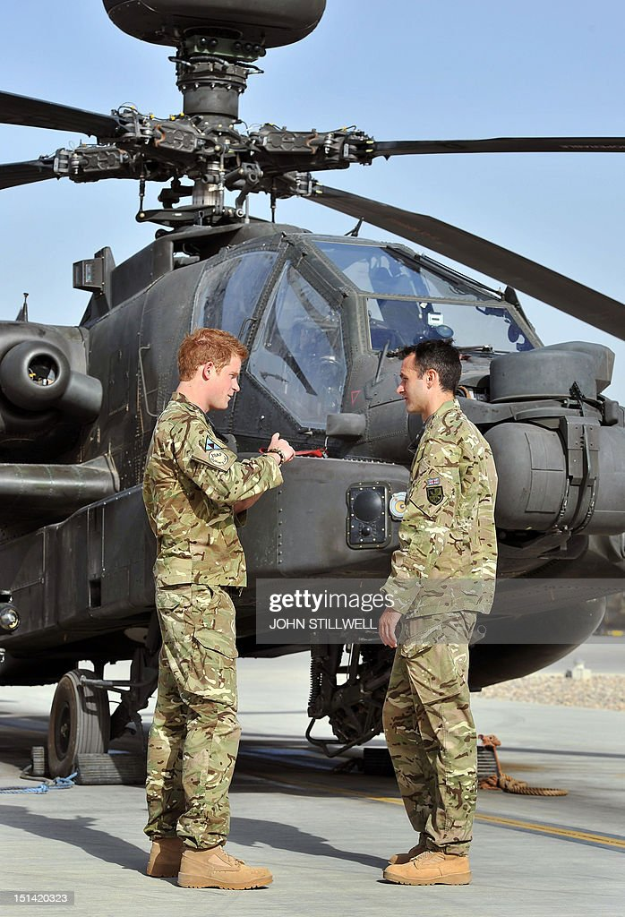 Britain's Prince Harry (L) is shown an Apache helicopter upon his arrival at Camp Bastion in Afghanistan, on September 7, 2012. Britain's Prince Harry is back in Afghanistan to serve as a military helicopter pilot four years after his previous deployment there had to be cut short, the Ministry of Defence said on Friday.