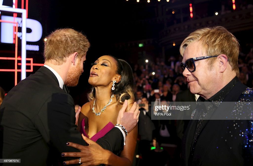 Britain's Prince Harry kisses Beverley Knight as Elton John looks on, after the Royal Variety Performance at the Albert Hall on November 13, 2015 in London, England.