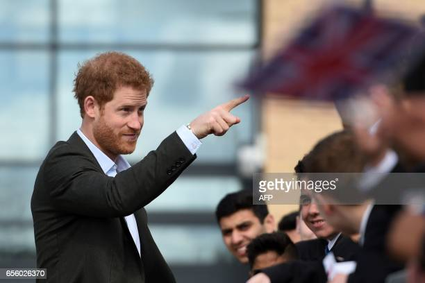 Britain's Prince Harry leaves after meeting representatives and pupils of the Yes You Can personal development project which works to help...