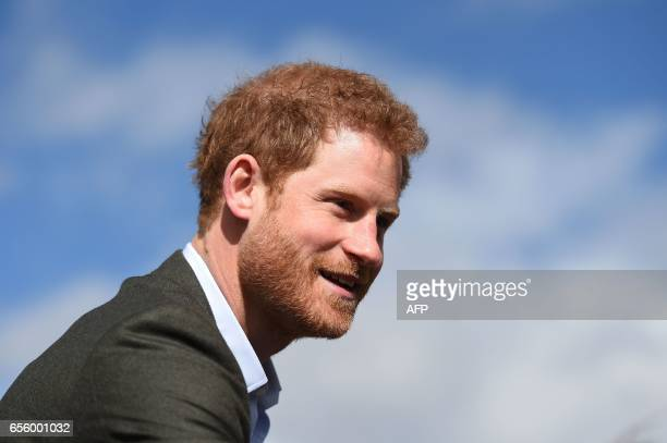 Britain's Prince Harry leaves after meeting representatives of the Yes You Can personal development project which works to help underperforming Year...