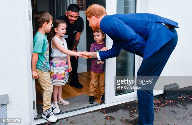 Britain's Prince Harry meets children during his tour of Walking With The Wounded 's training house and facilities in Canada Street Manchester...