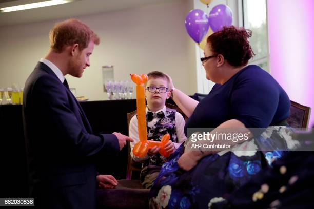 Britain's Prince Harry meets Finley Green winner of the Inspirational Child Award aged 46 with his mother Jennifer as he attends the WellChild Awards...