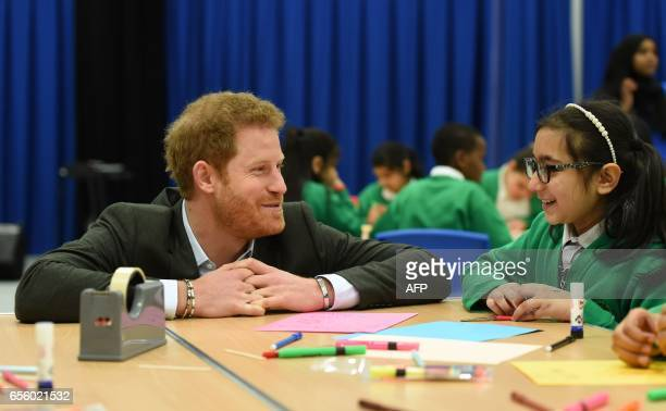 Britain's Prince Harry meets pupils on the Yes You Can personal development project which works to help underperforming Year 8 pupils to reach their...