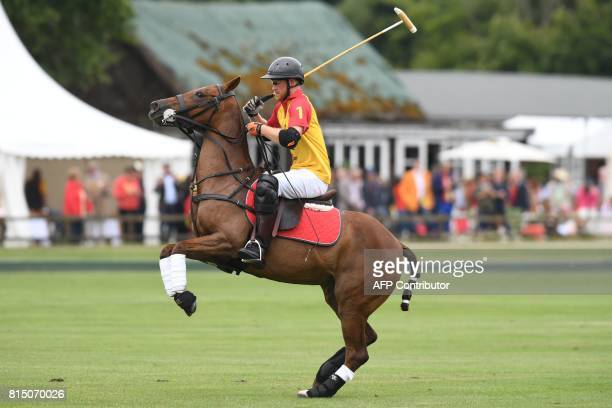 TOPSHOT Britain's Prince Harry plays for Foxcote in the Jerudong Park Trophy Final against CPPC at Cirencester Park Polo Club central England on July...