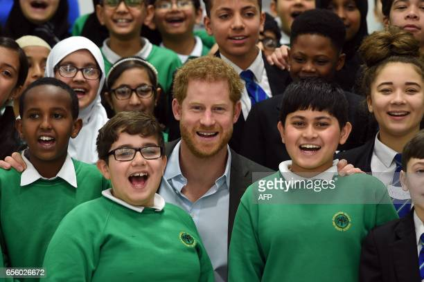 Britain's Prince Harry poses for a photograph with pupils from the Yes You Can personal development project which works to help underperforming Year...
