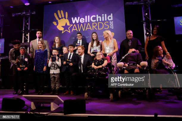 Britain's Prince Harry poses with the winners of the WellChild Awards in following the presentation ceremony London on October 17 2017 The awards...