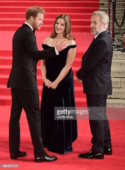Britain's Prince Harry producer Barbara Broccoli and British director Sam Mendes talk on arrival for the world premiere of the new James Bond film...