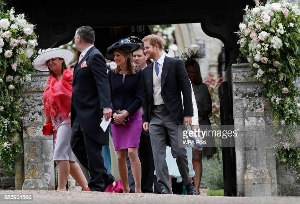 Britain's Prince Harry right leaves after the wedding of Pippa Middleton and James Matthews at St Mark's Church on May 20 2017 in Englefield...