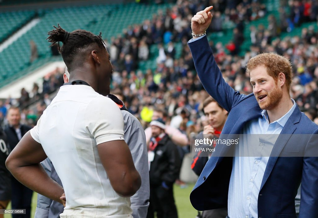 Britain's Prince Harry, right, speaks with England player Maro Itoje during a visit to an England Rugby Squad training session at Twickenham Stadium on February 17, 2017 in London, England. In his new role as Patron of the Rugby Football Union (RFU), Prince Harry attended the England rugby team open training session.