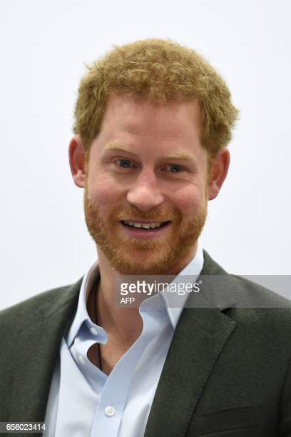 Britain's Prince Harry smiles as he speaks to representatives of the Yes You Can personal development project which works to help underperforming...