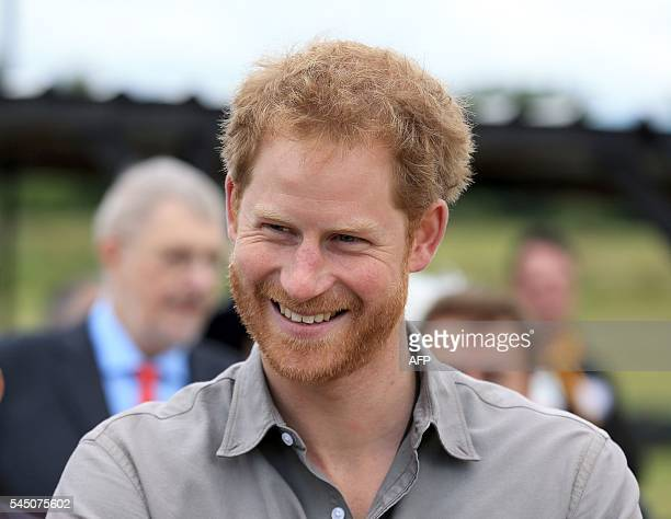 Britain's Prince Harry smiles as he visits The Blair Project at Three Sisters Racing Circuit in Wigan north west England on July 5 2016 Prince Harry...