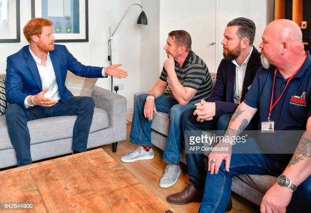 Britain's Prince Harry speaks at a round table meeting during his tour of Walking With The Wounded 's training house and facilities in Canada Street...
